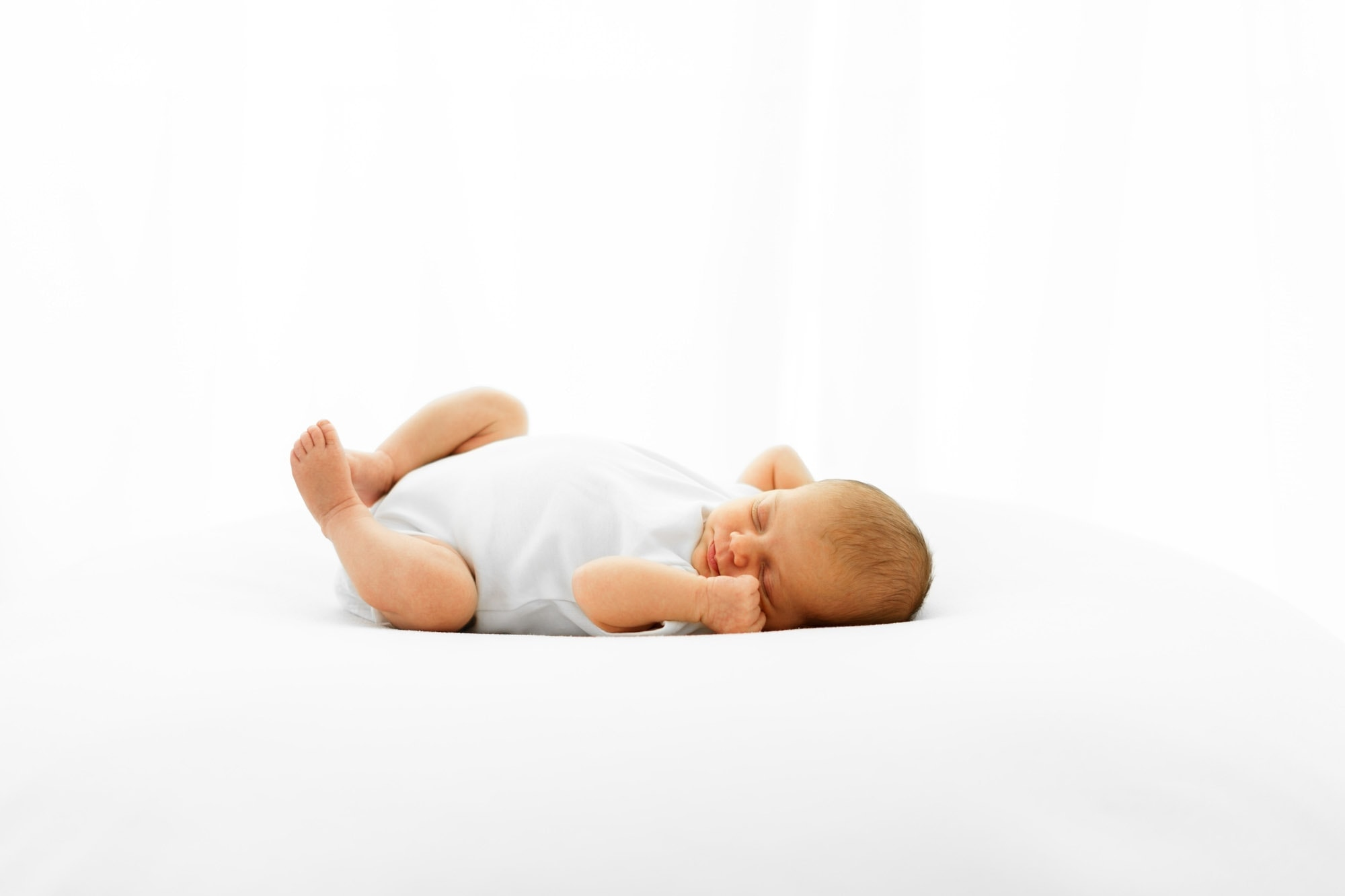 baby photographed naturally during session with norwich baby photographerw